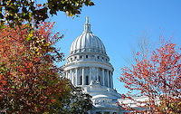 The Wisconsin State Capitol Building is seen through the autumn trees on the Capitol Square on Saturday, October 17, 2015 in Madison, Wisconsin