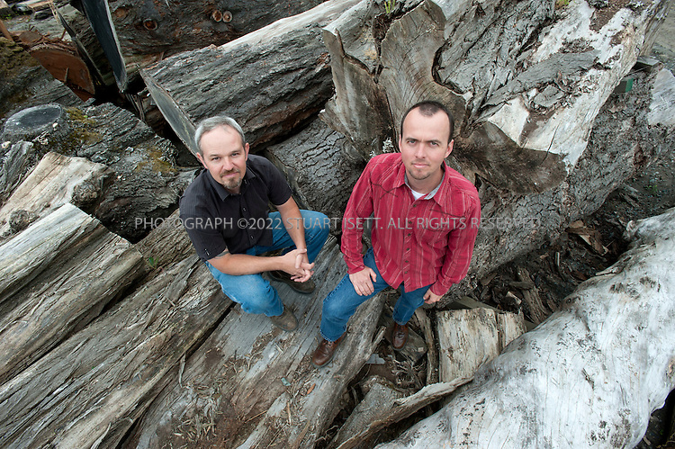 7/28/2010--Seattle, WA USA..Meyer Wells builds modern furniture from reclaimed urban trees in their facility in Seattle, WASH. ..Seth Meyer (left) and John Wells (right), posing with trees soon to turned into furniture, started the company and have successfully merged their environmental idealism with a business model that plays right into the Pacific Northwest's passion for sustainable forests. ..Meyer Wells harvests development-doomed or storm-damaged urban trees from Seattle neighborhoods and builds high-end custom furniture. The business is four years old and has grown every year in defiance of the recession; in 2009 they had $850,000 in gross sales. ..©2010 Stuart Isett. All rights reserved.