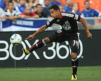 Andy Najar #14 of D.C. United pulls in a pass during an international charity match against the national team of El Salvador at RFK Stadium, on June 19 2010 in Washington DC. D.C. United won 1-0.