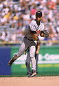 CIRCA 1996: Roberto Alomar #12 of the Baltimore Orioles fielding  during a game from his 1996 season agaisnt the Chicago White Sox. Roberto Alomar played 17 seasons, with 7 different teams, was a 12-time All-Star and inducted to the Baseball Hall of Fame in 2011.  (Photo by: 1996 SportPics)  *** Local Caption *** Roberto Alomar