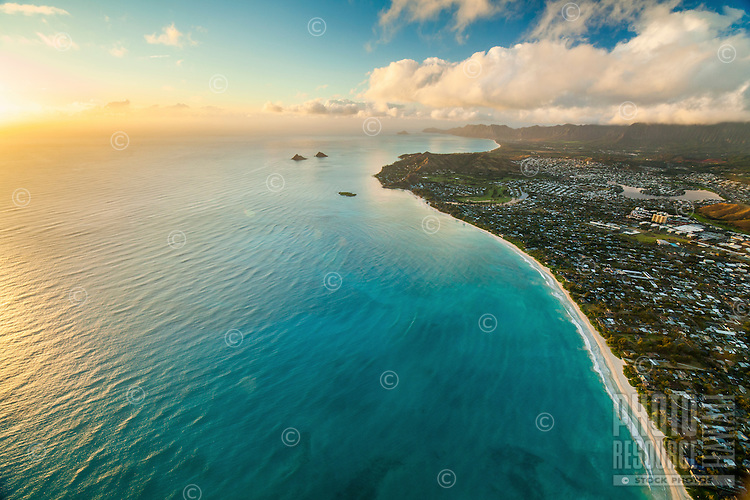 Sunrise over Kailua Bay and Beach, with Lanikai, Waimanalo and other neighborhoods beyond, Windward O'ahu.
