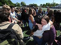 NWA Democrat-Gazette/ANDY SHUPE<br /> Emma McLellan (center), 17, a senior at Fayetteville High School, and Kelly Riley (right), an English and composition teacher at the school, embrace Friday, May 5, 2017, during the ninth annual Moving Up ceremony at Harmon Stadium at the school. After recognitions for group and team achievements, seniors are given the opportunity to speak to their teachers as they leave the school for the final time. Members of the freshman, sophomore and junior classes then move up ceremoniously to the next grade level.