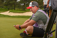 Sung Hyun Park's (KOR) caddie relaxes for a moment during the trophy presentation after winning the 2018 KPMG Women's PGA Championship, Kemper Lakes Golf Club, at Kildeer, Illinois, USA. 7/1/2018.<br /> Picture: Golffile | Ken Murray<br /> <br /> All photo usage must carry mandatory copyright credit (&copy; Golffile | Ken Murray)