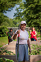 Residents and CPDC staff work in the community garden at Mayfair Mansions on June 25, 2013 in Washington, D.C.<br /> <br /> (Photo by http://momentacreative.com)