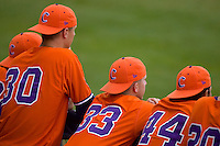 (L-R) Will Lamb #30, Scott Weismann #33 and Tomas Cruz #44 of the Clemson Tigers try to get something going by wearing rally caps at Durham Bulls Athletic Park May 22, 2009 in Durham, North Carolina.  (Photo by Brian Westerholt / Four Seam Images)