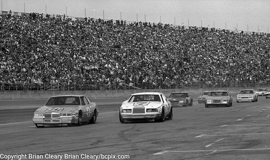 Richard Petty Kyle Petty laed pack pit road pit stops Daytona 500 at Daytona International Speedway in Daytona Beach, FL in February 1985. (Photo by Brian Cleary/www.bcpix.com) Daytona 500, Daytona International Speedway, Daytona Beach, FL, February 1985. (Photo by Brian Cleary/www.bcpix.com)