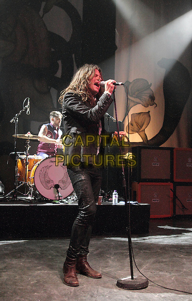Rival Sons .Performing live, at the O2 Shepherds Bush Empire, London, England..April 9th 2013 .on stage in concert gig performance music full length black jacket singing jeans denim .CAP/ROS.©Steve Ross/Capital Pictures