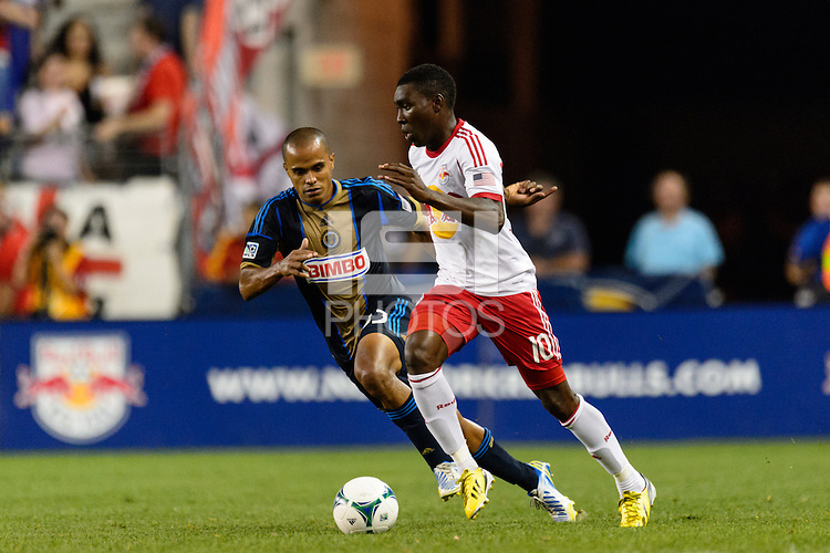 Lloyd Sam (10) of the New York Red Bulls is marked by Fabio Alves (Fabinho) (33) of the Philadelphia Union. The New York Red Bulls and the Philadelphia Union played to a 0-0 tie during a Major League Soccer (MLS) match at Red Bull Arena in Harrison, NJ, on August 17, 2013.