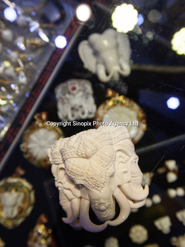 Ivory is seen on sale in an illegal shop, not authorised by China's State Forestry Administration, Li Wan District, Guangzhou, Guangdong Province, China, 28 November 2013. <br /> <br /> Photo by Alex Hofford / Sinopix