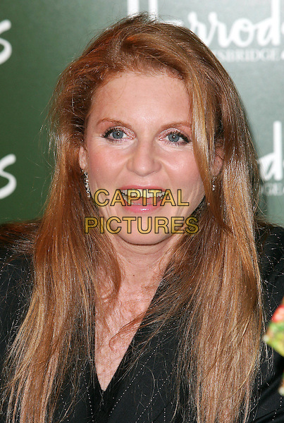 SARAH FERGUSON - DUCHESS OF YORK - FERGIE.Book Signing at Harrods of her 8th Children's Book, Little Red's Christmas Story..October 28th, 2004.headshot portrait.www.capitalpictures.com.sales@capitalpictures.com.©Capital Pictures.