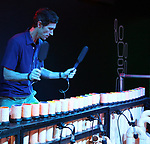 """Matt Ramsey, Blue Man cast member performing during """"Blue Man Group: Ready...Go!"""" press preview exhibit at the Museum of the City of New York on July 16, 2019 in New York City."""