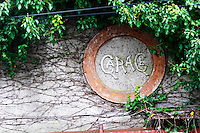 A round circular sign saying Garage. Perhaps indicating that there is garage wine being made here? Bodega Vinos Finos H Stagnari Winery, La Puebla, La Paz, Canelones, Montevideo, Uruguay, South America