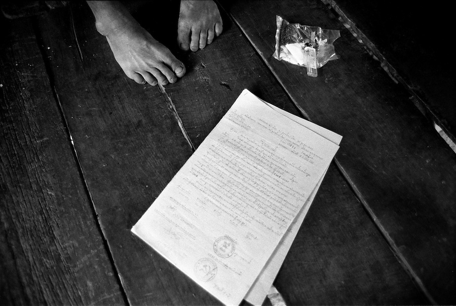 """Mekong Dam Victims - Laos.  A letter to the dam company from one of the villages that will be relocated with the expansion of the dam. The letter is describing the villagers requests regarding the positioning and organization of the new village. After the construction of the Theun-Hinboun Dam in Laos more than 29,000 people in 71 villages have lost fisheries, rice fields, vegetables gardens and fresh drinking water supplies as a result of the dam. An expansion project is currently under construction and will displace another 4,200 mostly indigenous people from their lands in the reservoir area and displace or negatively affect another 50,000 people living downstream, on project construction lands, and in resettlement host villages. Known as """"The Mother of Waters"""", more than 60 million people depend on the Mekong river and its tributaries for food, fresh water, transport and other aspects of daily life. The construction of big dams is now threatening the life of these people aswell as the vital and unique ecosystem of the river."""