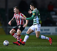 Lincoln City's Harry Anderson shields the ball from Yeovil Town's Mihai Dobre<br /> <br /> Photographer Andrew Vaughan/CameraSport<br /> <br /> The EFL Sky Bet League Two - Lincoln City v Yeovil Town - Friday 8th March 2019 - Sincil Bank - Lincoln<br /> <br /> World Copyright © 2019 CameraSport. All rights reserved. 43 Linden Ave. Countesthorpe. Leicester. England. LE8 5PG - Tel: +44 (0) 116 277 4147 - admin@camerasport.com - www.camerasport.com