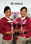 November 18, 2016, Tokyo, Japan - Cabin attendants of Japan's budget airline Peach Aviation display a scale model of Airbus A320 as Peach will buy 13 aircrafts of Airbus A320 at a press conference in Tokyo on Friday, November 18, 2016. Peach will purchase 3 A320 ceo aircrafts in 2018 and will receive the first A320 neo in 2019 from the Airbus.   (Photo by Yoshio Tsunoda/AFLO) LWX -ytd-
