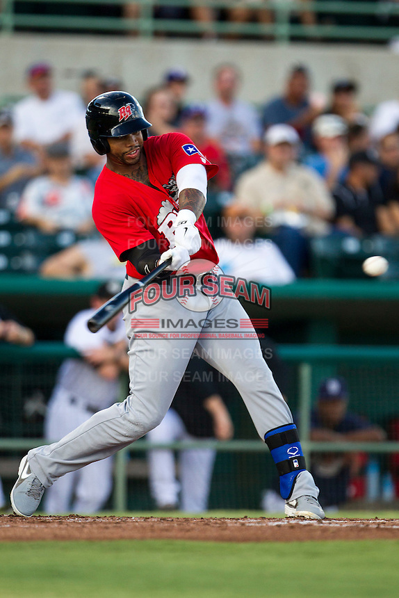 Frisco Roughriders designated hitter Kalian Sams (26) swings the bat in the Texas League baseball game against the San Antonio Missions on August 22, 2013 at the Nelson Wolff Stadium in San Antonio, Texas. Frisco defeated San Antonio 2-1. (Andrew Woolley/Four Seam Images)