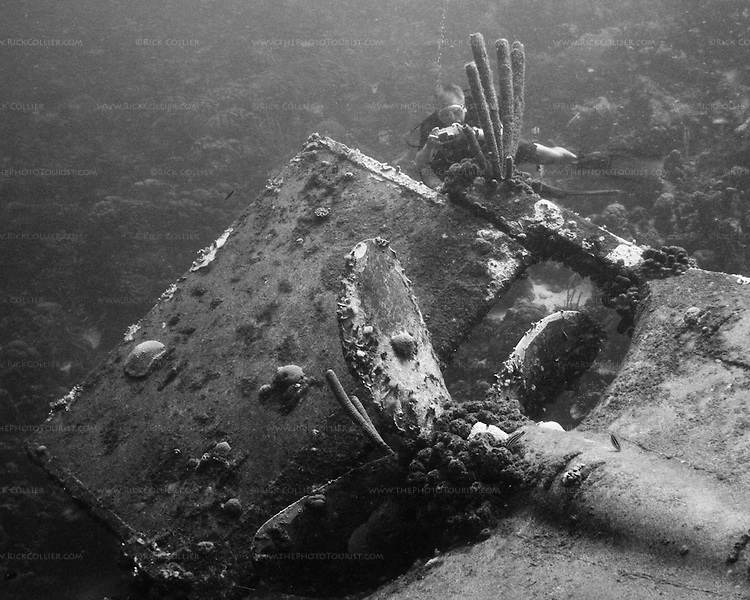 "Diving Bonaire, Netherland Antilles -- A diver takes pictures at the propeller of the ""Hilma Hooker.""  (""Hilma Hooker"" dive site)."