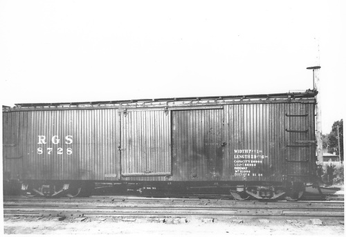 RGS box car #8728 in yard.<br /> RGS    Taken by Ward, Bert H. - Post 5/21/1938