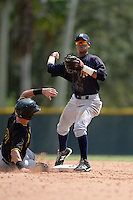 New York Yankees second baseman Thairo Estrada (59) turns a double play as Reese McGuire (7) slides in during an Instructional League game against the Pittsburgh Pirates on September 18, 2014 at the Pirate City in Bradenton, Florida.  (Mike Janes/Four Seam Images)