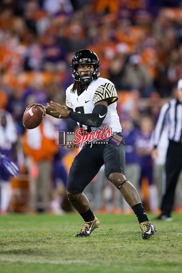Kendall Hinton (2) of the Wake Forest Demon Deacons looks to pass the football during second half action against the Clemson Tigers at Memorial Stadium on November 21, 2015 in Clemson, South Carolina.  The Tigers defeated the Demon Deacons 33-13.   (Brian Westerholt/Sports On Film)