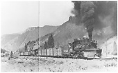 Engineer's side view of K-27 #464 with an 11 car freight and a helper locomotive cut in the middle on the Silverton Branch north of Durango.<br /> D&amp;RGW  Silverton Branch, CO