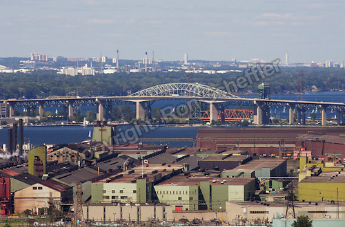 August 21, 2004. Hamilton, Ontario. The view of lower north Hamilton as seen from the escarpment looking north, over the city and beyond. Stelco Steel is in the foreground (large green and red/brown structures). Other landmarks include the Skyway bridge...Photo: Ron Scheffler