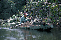 Fisherman in a dugout canoe, New River, Belize