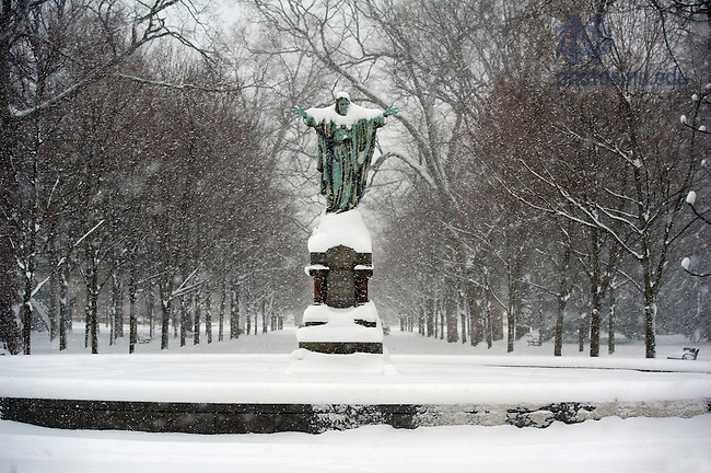January 3, 2012; Snow covers the Sacred Heart Jesus statue in the Main Quad. Photo by Barbara Johnston/University of Notre Dame.