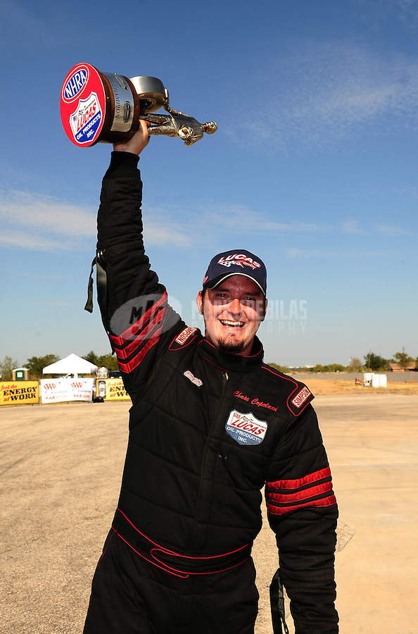 Sept. 25, 2011; Ennis, TX, USA: NHRA top alcohol dragster driver Chase Copeland celebrates after winning the Fall Nationals at the Texas Motorplex. Mandatory Credit: Mark J. Rebilas-
