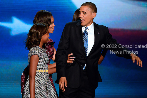 United States President Barack Obama looks as if he is surprised by his family on the podium following his acceptance speech at the 2012 Democratic National Convention in Charlotte, North Carolina on Thursday, September 6, 2012.  .Credit: Ron Sachs / CNP.(RESTRICTION: NO New York or New Jersey Newspapers or newspapers within a 75 mile radius of New York City)