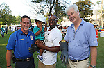 Kris Parker (C)  his son Cameron (23 months) wearing a JCP&L Hard Hat with Lieutenant Josh Bard (L) of the Long Branch, NJ Police Department and Jim Markey (R) Area Manager for JCP&L look on at the National Night Out in Long Branch, New Jersey on Tuesday August 2, 2016.<br /> <br /> MODEL RELEASE SIGNED