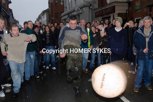 Shrove Tuesday Football. Atherstone Warwickshire UK 2008. Kicking the ball Long Street.