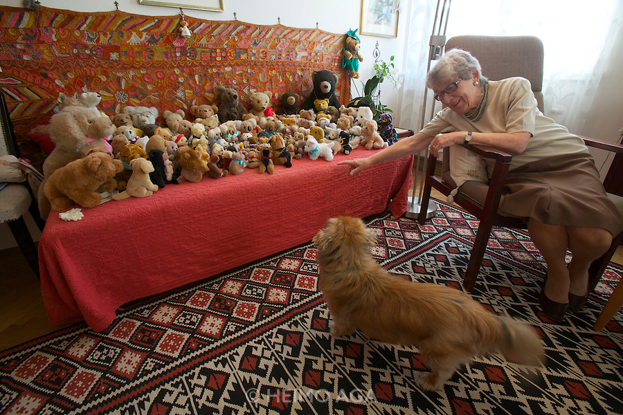 "Vienna, Karl-Marx-Hof. Doris Nasty, 82, lives here since 1930 when construction was finished, here with her Pekinese Wasti in the ""Bears Room""."