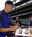 10 September 2006: Ubaldo Jimenez, pitcher for the Colorado Rockies, signs autographs prior to a game against the Washington Nationals. The Rockies defeated the Nationals 13-9 at Coors Field in Denver, Colorado...Mandatory Photo Credit: Ed Wolfstein.