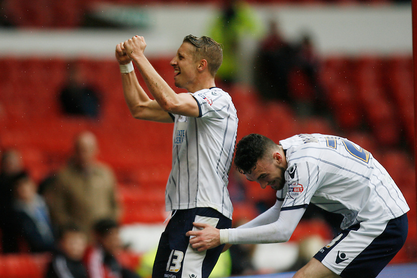 Millwall's Lee Martin (L) celebrates scoring his sides second goal <br /> <br /> Photo by Jack Phillips/CameraSport<br /> <br /> Football - The Football League Sky Bet Championship - Nottingham Forest v Millwall - Saturday 5th April 2014 - The City Ground - Nottingham<br /> <br /> &copy; CameraSport - 43 Linden Ave. Countesthorpe. Leicester. England. LE8 5PG - Tel: +44 (0) 116 277 4147 - admin@camerasport.com - www.camerasport.com