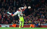 Per Mertesacker of Arsenal climbs over Jhon Cordoba of FC Koln during the UEFA Europa League match between Arsenal and FC Koln at the Emirates Stadium, London, England on 14 September 2017. Photo by Andrew Aleks.