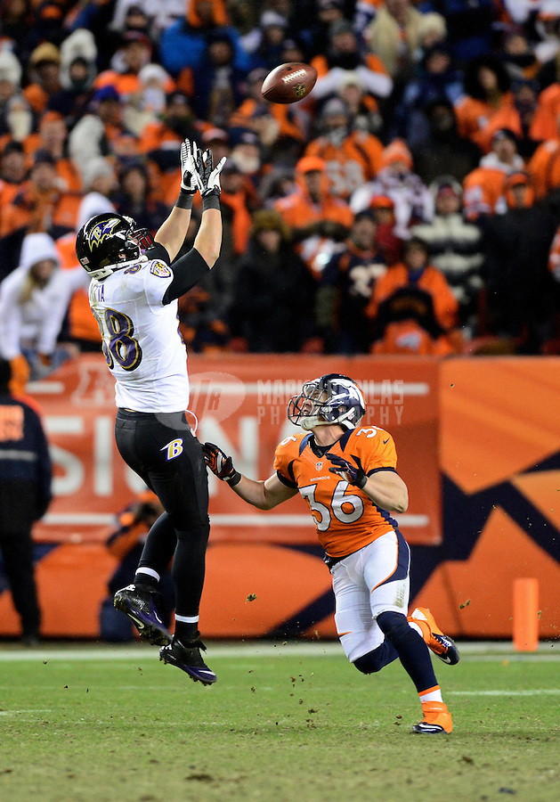 Jan 12, 2013; Denver, CO, USA; Baltimore Ravens tight end Dennis Pitta (88) catches a pass above Denver Broncos safety Jim Leonhard (36) during the AFC divisional round playoff game at Sports Authority Field.  Mandatory Credit: Mark J. Rebilas-