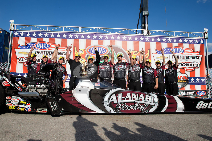 Sept. 2, 2013; Clermont, IN, USA: NHRA top fuel dragster driver Shawn Langdon celebrates with crew after winning the US Nationals at Lucas Oil Raceway. Mandatory Credit: Mark J. Rebilas-