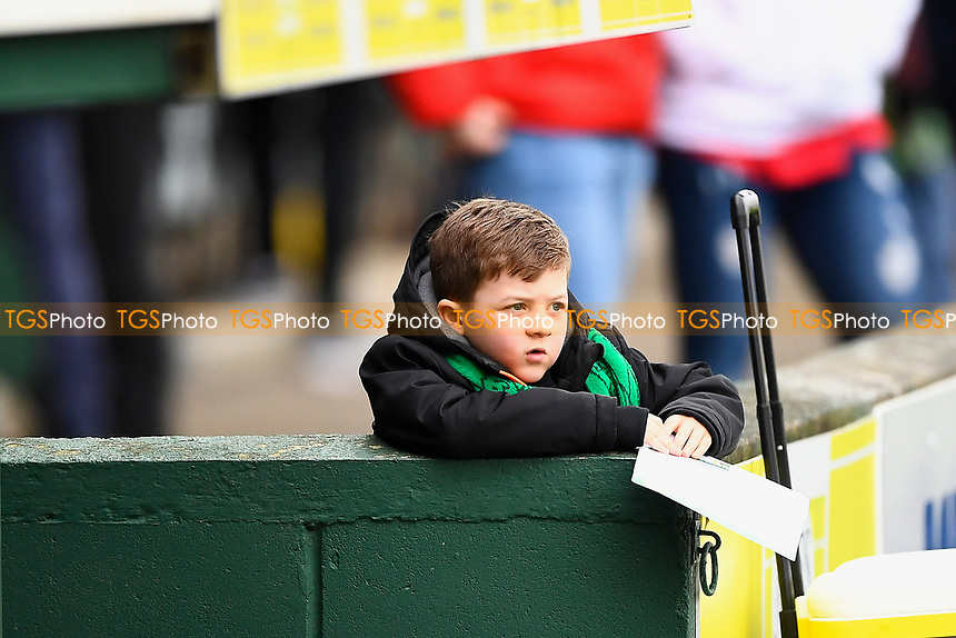 A young Yeovil Town fan waits patiently for an autograph during Yeovil Town vs Grimsby Town, Sky Bet EFL League 2 Football at Huish Park on 9th February 2019