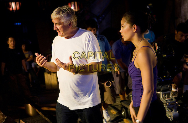 ANDRZEJ BARTKOWIAK (Director) & KRISTIN KREUK.on the set of Street Fighter: The Legend of Chun-Li .*Filmstill - Editorial Use Only*.CAP/FB.Supplied by Capital Pictures.
