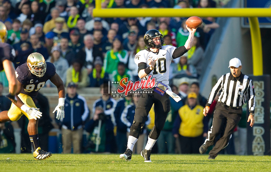 Wake Forest Demon Deacons quarterback Tanner Price (10) makes a throw as he rolls to his left during first quarter action against the Notre Dame Fighting Irish at Notre Dame Stadium on November 17, 2012 in South Bend, Indiana.  The Fighting Irish defeated the Demon Deacons 38-0.  (Brian Westerholt/Sports On Film)