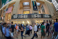 Travelers crowd Grand Central Terminal in New York on Friday, August 30, 2013, for the Labor Day weekend exodus.  Those that didn't leave on Wednesday or Thursday are getting out of town today. Travel during the holiday weekend is expected to be the highest since the recession.  (© Richard B. Levine