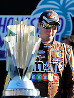 Nov. 16, 2008; Homestead, FL, USA; NASCAR Sprint Cup Series driver Kyle Busch walks by the championship trophy prior to the Ford 400 at Homestead Miami Speedway. Mandatory Credit: Mark J. Rebilas-