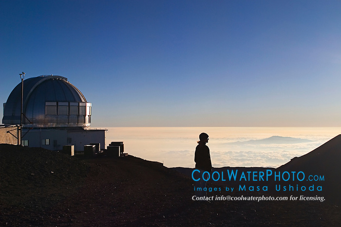 Woman visitor, United Kingdom Infrared Telescope or UKIRT, and Haleakala of Maui at distance, Mauna Kea Observatories, Big Island, Hawaii