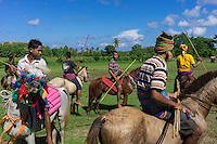 March 28, 2016 - Waiha (Indonesia). Riders wait to start a new wave of attacks. A skilled rider can duck an incoming spear and the very best of them can catch the spear in mid-air. For the less agile, the spears, though blunted, can spill blood, which the Sumbanese believe will fertilize the land and produce a better harvest. © Thomas Cristofoletti / Ruom