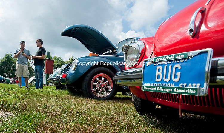 WINSTED, CT-12 AUGUST 2012--081212JS01- Andrew Lapointe of Hudson, Mass, left and his friend Brian Dimetres of Long Meadow, Mass, right, chat during the 21st Annual Terryville Lions Club's  Bug-A-Fair car show Sunday at the Terryville Fairgrounds. .Jim Shannon Republican-American