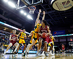 SIOUX FALLS, SD - MARCH 7: Robert Jones #21 of the Denver Pioneers tries to go up for a shot against Rocky Kreuser #34 of the North Dakota State Bison at the 2020 Summit League Basketball Championship in Sioux Falls, SD. (Photo by Richard Carlson/Inertia)