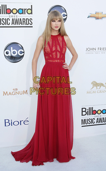 Taylor Swift.Arriving at the 2012 Billboard Music Awards at MGM Grand in Las Vegas, Nevada, USA..May 20th, 2012.full length red lace sleeveless dress hand on hip.CAP/ROT/TM.©Tony Michaels/Roth Stock/Capital Pictures