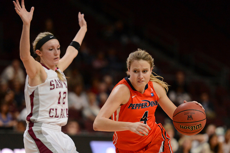 March 6, 2014; Las Vegas, NV, USA; Pepperdine Waves guard Grace Leah Baughn (4) dribbles against Santa Clara Broncos guard Nici Gilday (12) during the second half of the WCC Basketball Championships at Orleans Arena. The Waves defeated the Broncos 80-74.