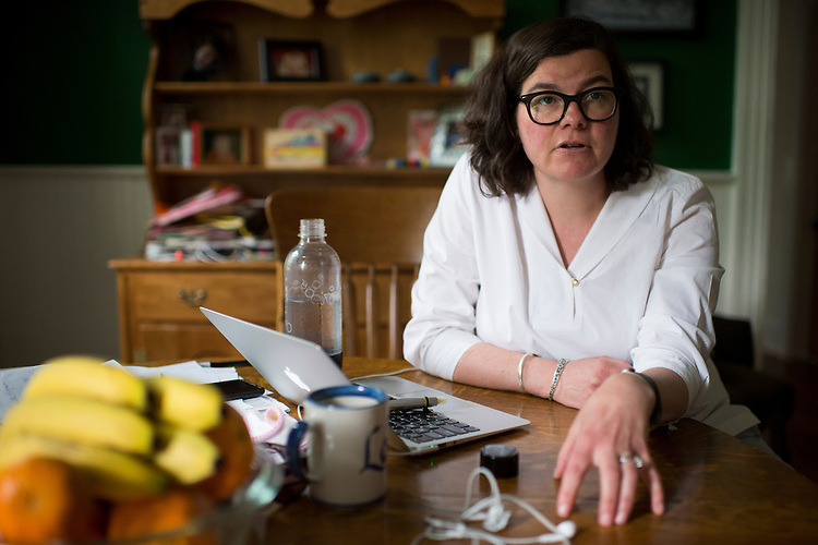 UNITED STATES - MAY 5: Democratic campaign consultant Martha McKenna coordinates volunteer efforts at her dining room table in Baltimore on Tuesday, May 5, 2015. In the wake of the unrest in Baltimore, McKenna organized food deliveries, and on this day, flower deliveries to senior citizen facilities in the areas of the city affected by the Freddie Gray riots. (Photo By Bill Clark/CQ Roll Call)